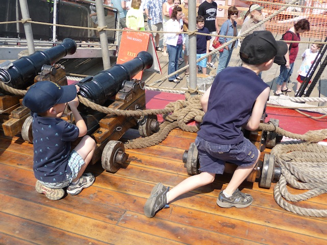 Boys playing on the deck of HMS Bounty
