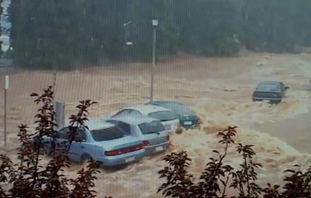 Cars swept away in Brisbane flooding
