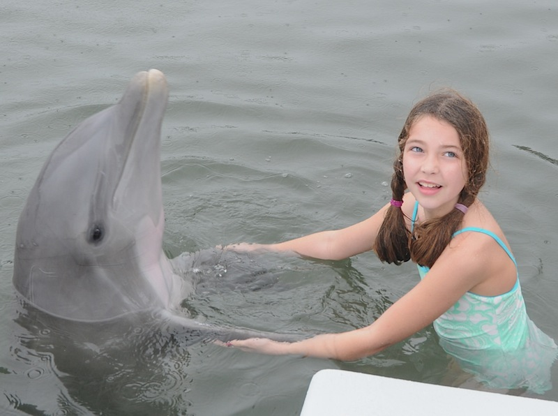 Lucy with dolphin