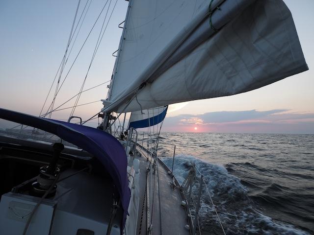 Lunacy sailing in sunset